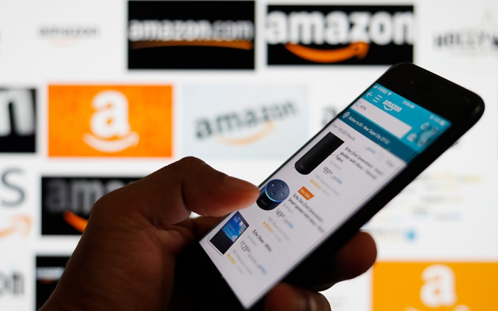 An online shopper browses shopping deals from the Amazom mobile app in Taipei, Taiwan, 05 September 2018. Amazon.com Inc. has become the second publicly traded US company to reach one trillion US dollars in market value. Last month Apple Inc. was the first company to be valued at 1 trillion US dollars.Amazon.com Inc is 2nd US company to reach 1 trillion dollar market value, Taipei, Taiwan - 05 Sep 2018