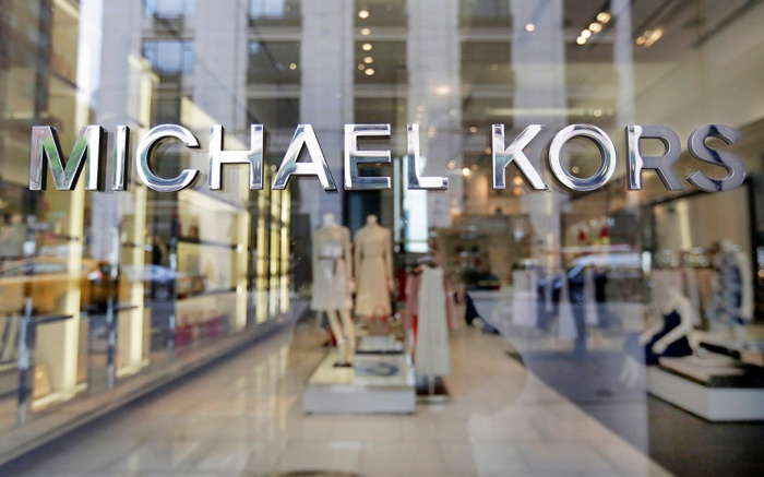 The Michael Kors name adorns his store on Madison Avenue, in New York. Michael Kors is buying the Italian fashion house Gianni Versace in a deal worth more than $2 billion in a hard charge into the world of high end fashion. The deal announced, follows the New York handbag maker's $1.35 billion acquisition last year of the high-end shoemaker Jimmy ChooVersace Sale, New York, USA - 31 May 2017
