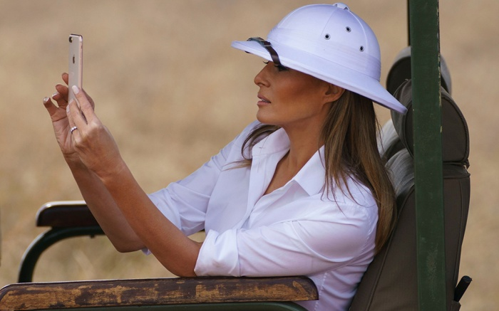 First lady Melania Trump takes photos with her cell phone during a safari at Nairobi National Park in Nairobi, Kenya, . Melania Trump has fed baby elephants as she visits a national park in Kenya to highlight conservation efforts. The U.S. first lady also went on a quick safari. Mrs. Trump is on her first-ever visit to Africa and her first extended solo international trip as first ladyMelania Trump Africa, Nairobi, Kenya - 05 Oct 2018