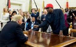 US entertainer Kanye West (R) shows