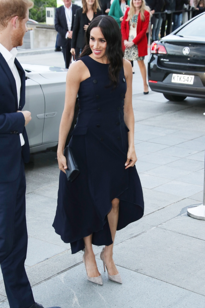 Meghan Markle wears an Antonio Berardi dress and Aquazzura pumps.