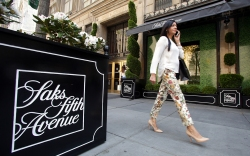 A woman passes by a Saks