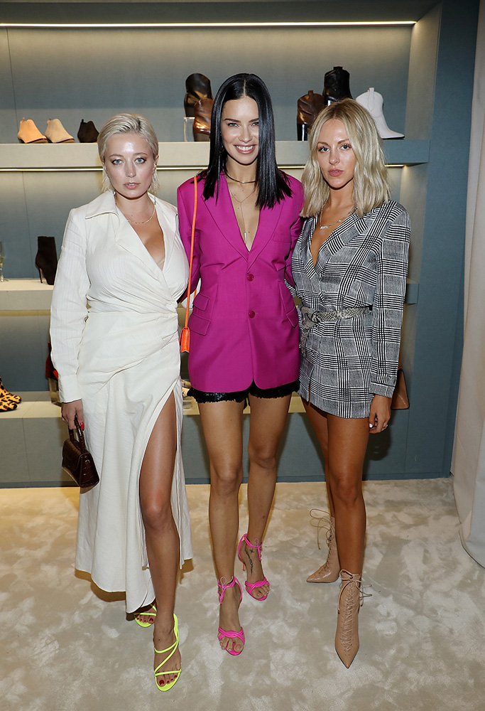 MIAMI, FL - NOVEMBER 13: Caroline Vreeland, Adriana Lima, and Shea Marie attend Schutz Aventura Store Opening Cocktail Party on November 13, 2018 in Miami. (Photo by Alexander Tamargo/Getty Images for Schutz)