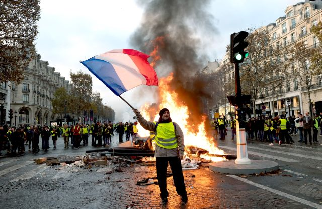 Clashes broke out between crowds and police on the Champs Élysées in the second weekend of demonstrations.'Gilets Jaunes' protest against rising fuel prices, Paris, France - 24 Nov 2018Thousands had travelled from across France to show their anger at the French president, Emmanuel Macron, and the government. The interior minister, Christophe Castaner, said 8,000 protesters had arrived in Paris by mid-morning, 5,000 of them on the Champs Élysées, which had been closed off.
