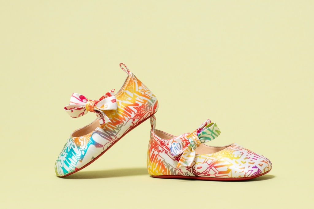 Christian Louboutin's Mary Jane-inspired baby shoes featuring a rainbow graphic print