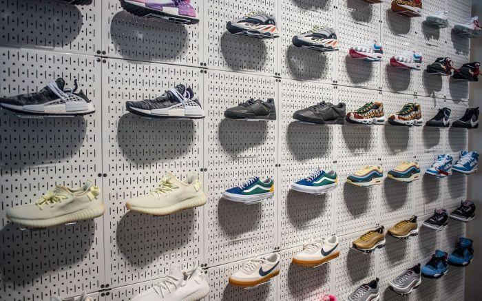 Sneaker wall at Stadium Goods store inside Neighborhood Goods concept
