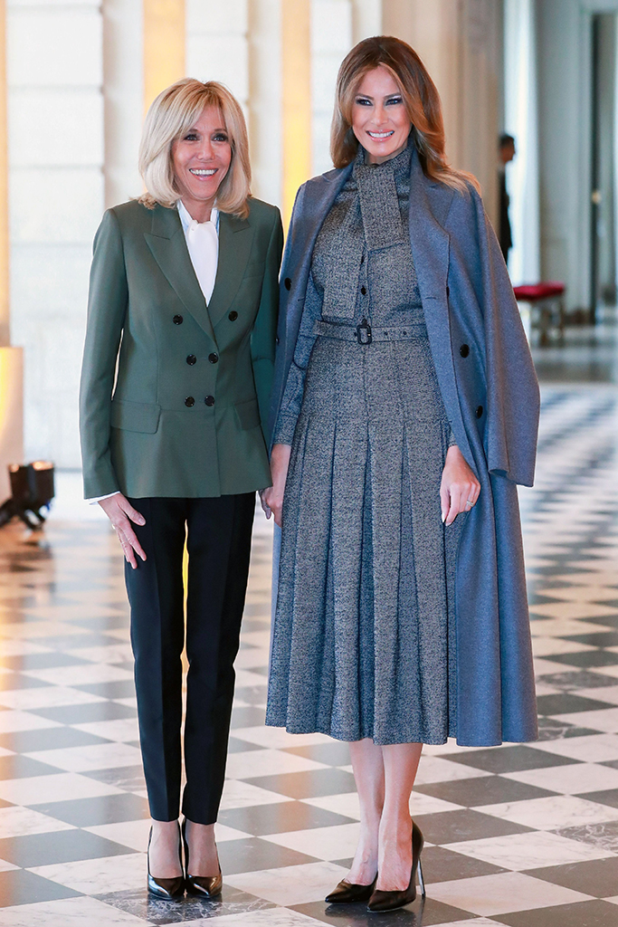 French First lady Brigitte Macron (L) welcomes US First Lady Melania Trump (R) before a partner's lunch on the side of the international ceremony for the Centenary of the WWI Armistice of 11 November 1918 in Versailles Castle in Versailles, France, 11 November 2018. World leaders have gathered in France to mark the 100th anniversary of the First World War Armistice with services taking place across the world to commemorate the occasion.Commemoration of the Centenary of the end of the First World War- Partners's lunch, Versailles, France - 11 Nov 2018