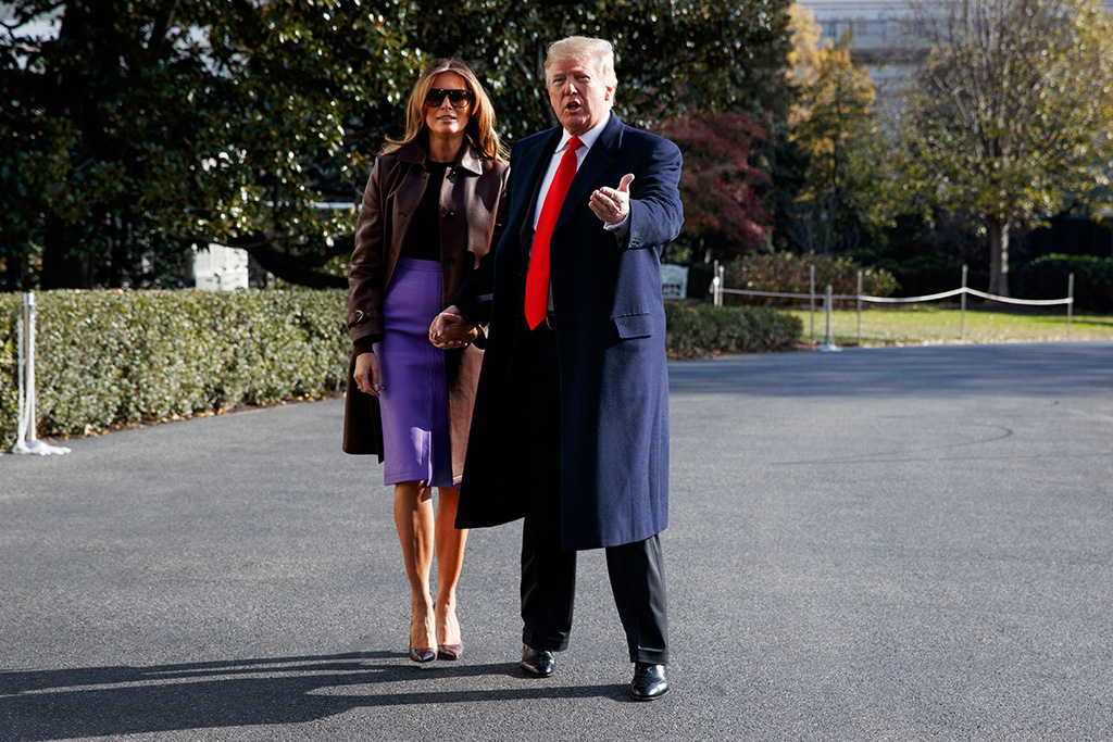 First lady Melania Trump looks on as President Donald Trump talks with reporters before traveling to the G20 Summit in Buenos Aires, on the South Lawn of the White House, in WashingtonTrump Argentina G20 Summit, Washington, USA - 29 Nov 2018