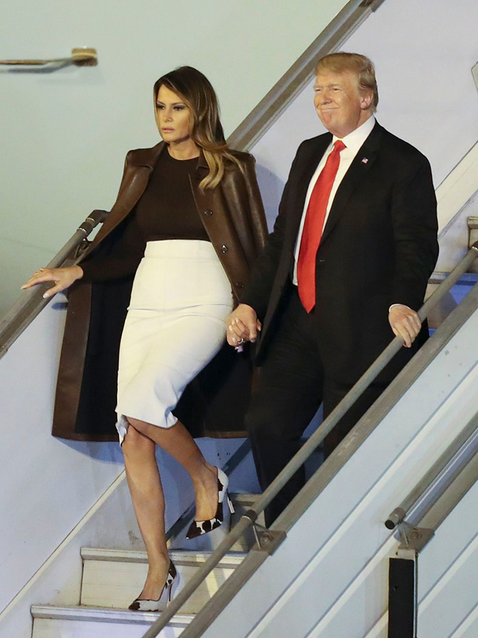 President Donald Trump and first lady Melania Trump walk from Air Force One, as they arrive at the Ministro Pistarini international airport in Buenos Aires, Argentina. Trump traveled to Argentina to attend the G20 summitG20 Summit, Buenos Aires, Argentina - 29 Nov 2018