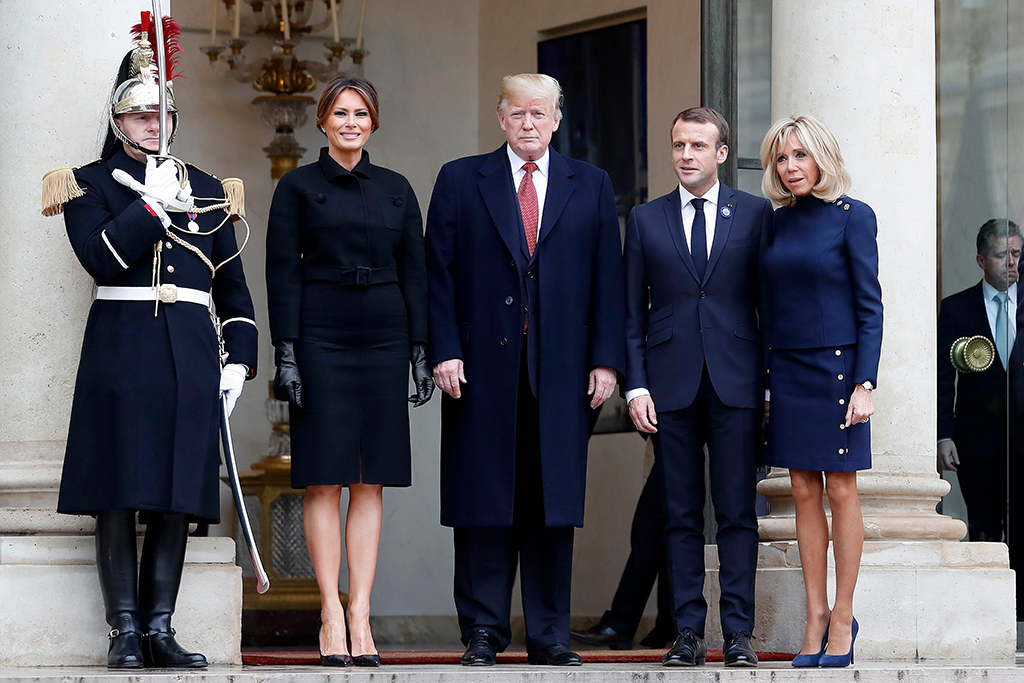 French President Emmanuel Macron (2-R) and French First Lady Brigitte Macron (R) greet US President Donald J. Trump (C) and US First Lady Melania Trump (2-L) as they leave the Elysee Palace following their meeting in Paris, France, 10 November 2018. US President Trump along with other Heads of States and Governments will join on 11 November the commemoration ceremonies for their countries' fallen WW1 soldiers in France.Commemoration of the Centenary of the end of the First World War, Paris, France - 10 Nov 2018