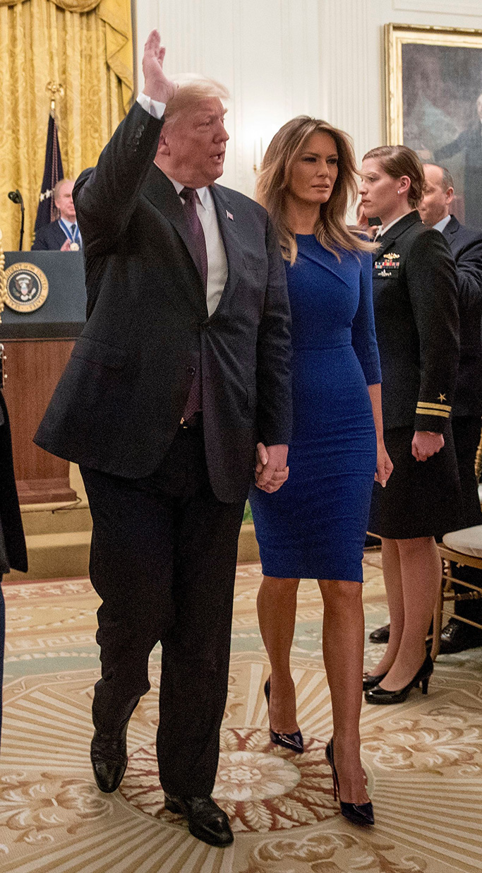 President Donald Trump and first lady Melania Trump depart a Medal of Freedom ceremony in the East Room of the White House in WashingtonTrump Medal of Freedom, Washington, USA - 16 Nov 2018