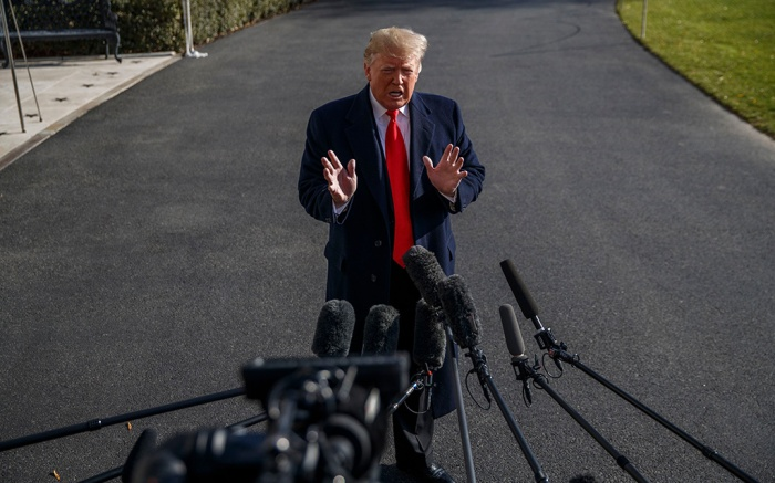 US President Donald J. Trump (C) responds to a question from the news media as he walks to board Marine One on the South Lawn of the White House in Washington, DC, USA, 29 November 2018. President Trump is traveling to the G20 Summit, which will take place between from 31 November to 01 December 2018 in Argentina. Trump is scheduled to meet with Russian President Vladimir Putin and Chinese President Xi Jinping.US President Donald J. Trump departs the White House for the G20 in Argentina, Washington, USA - 29 Nov 2018