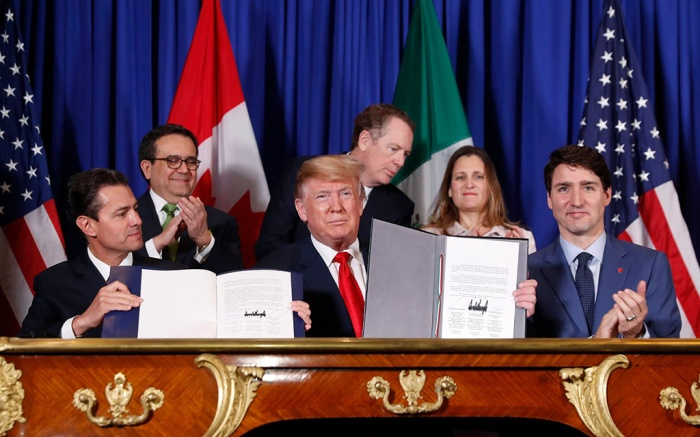 President Donald Trump, Canada's Prime Minister Justin Trudeau, right, and Mexico's President Enrique Pena Neto, left, participate in the USMCA signing ceremony, in Buenos Aires, ArgentinaTrump G20 Summit, Buenos Aires, Argentina - 30 Nov 2018