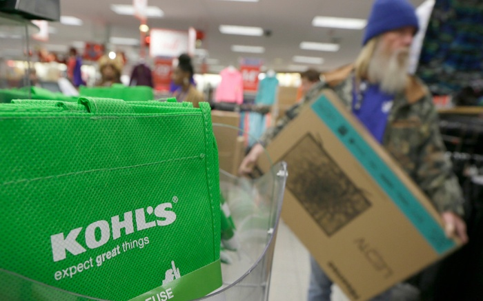 A customer carries a $99 television from the checkout at a Kohl's department store in Sherwood, ArkHoliday Shopping Thanksgiving, Sherwood, USA