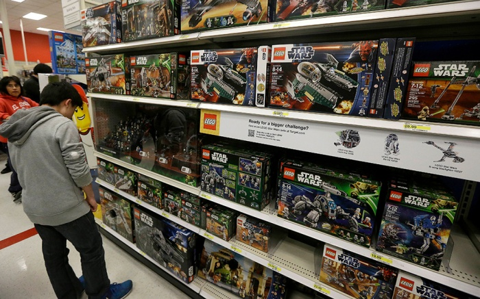 A man looks at Star Wars Lego toys displayed at a Target Store in Colma, Calif., . Instead of waiting for Black Friday, which is typically the year's biggest shopping day, more than a dozen major retailers are opening on Thanksgiving day this yearHoliday Shopping, Colma, USA