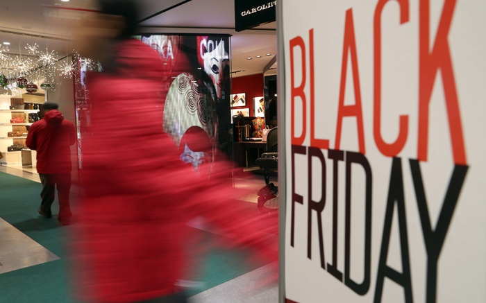 A Man Walks Past a Sign Advertising Black Friday Sales at a Shop in Madrid Spain 25 November 2016 Black Friday a Traditional Bargain Sales Day in Usa is Growing Popularity in Spain Each Year More Shops Join the Black Friday Offers That Attract Customers Days Before the Christmas Season Spain MadridSpain Shopping Black Friday - Nov 2016