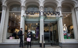 Shoppers stand outside the Bloomingdale's store