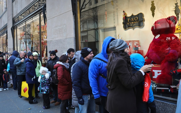 Holiday consumers wait in a line extending a block to shop at FAO Schwarz, in New York. The holiday shopping season presents a big test for a U.S. economy, with overall growth so far this year relying on a burst of consumer spendingHoliday-Black Friday, New York, USA - 23 Nov 2018