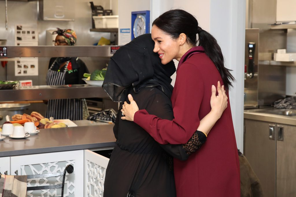 Meghan Duchess of Sussex greets people as she arrives to visit the Hubb Community Kitchen to see how funds raised by the 'Together: Our Community' Cookbook are making a difference at Al Manaar, North KensingtonMeghan Duchess of Sussex visit to the Hubb Community Kitchen, London, UK - 21 Nov 2018