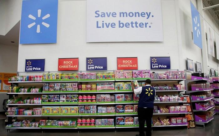 A Walmart worker stocks shelves
