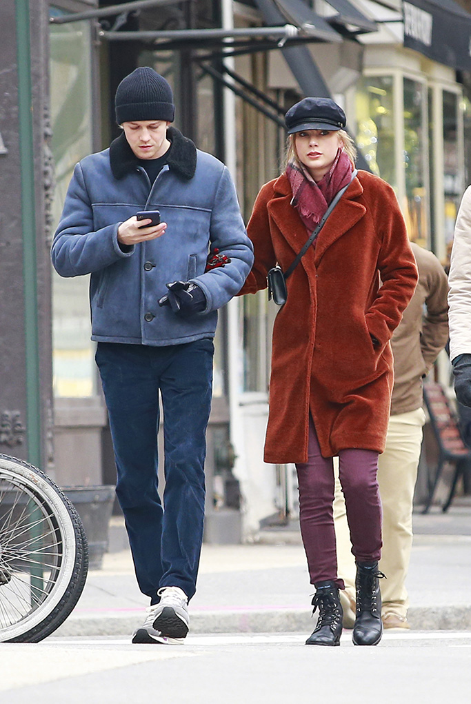 "Taylor Swift and Joe Alwyn walk arm in arm while heading to New Year's lunch with Joe's brothers Thomas and Patrick Alwyn in New York City. Taylor was wearing a burnt orange wool coat paired with plum-colored pants, boots, sailor cap and an Yves Saint Laurent cross-body purse. The party walked from Tribeca to the West Village over to Joe's ""The Favourite"" movie Emma Stone's apartment for lunch.Pictured: Ref: SPL5052103 301218 NON-EXCLUSIVEPicture by: Edward Opi / SplashNews.comSplash News and PicturesLos Angeles: 310-821-2666New York: 212-619-2666London: 0207 644 7656Milan: 02 4399 8577photodesk@splashnews.comWorld Rights"