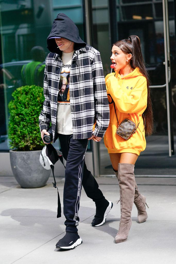Ariana Grande, yellow hoodie, stuart weitzman, thigh-highs