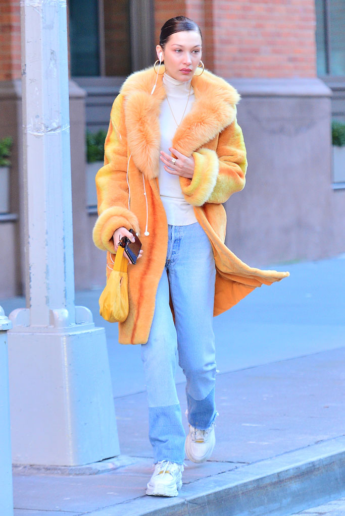 Bella Hadid, fashion, celebrity style, street style, 2018, jeans, orange furry coat, maison margiela, sneakers