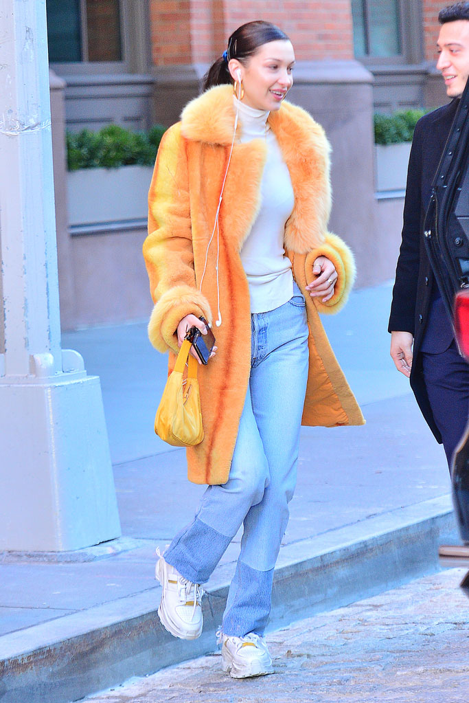 Bella Hadid, orange coat, maison margiela, sneakers, new york city, street style, celebrity style, off-duty style