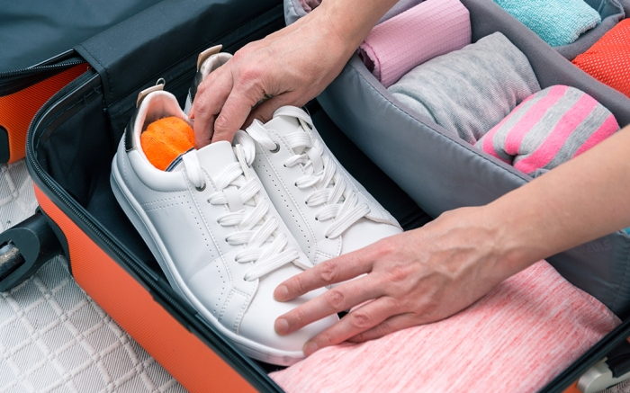 how to pack shoes for travel
