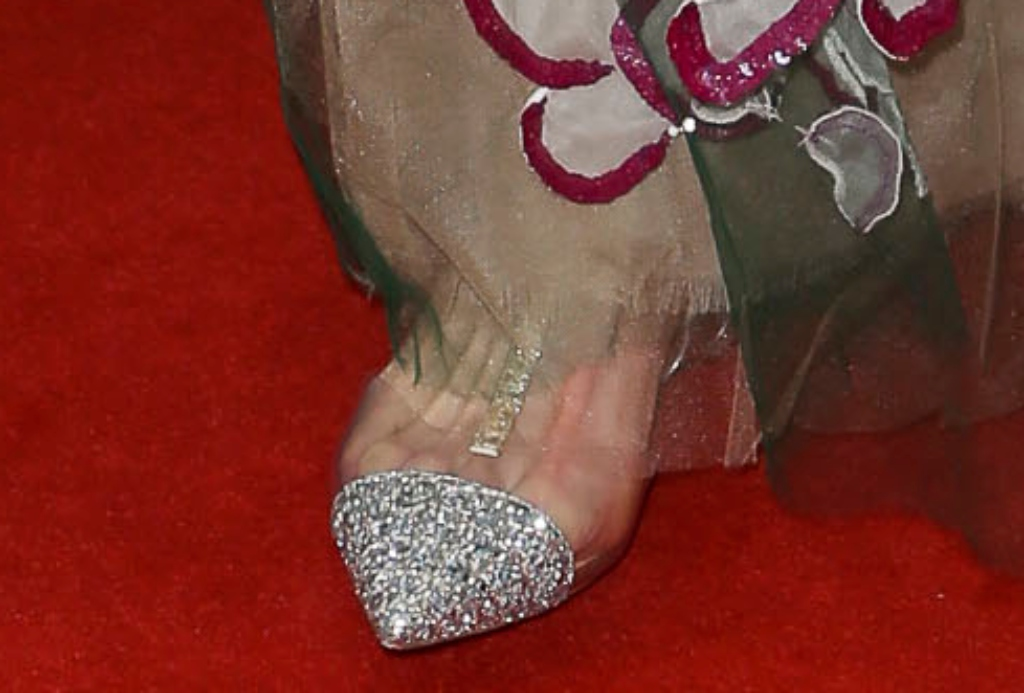 Nicole Kidman wearing Louboutin's Nosy Flat Silver glitter and PVC t-strap flat