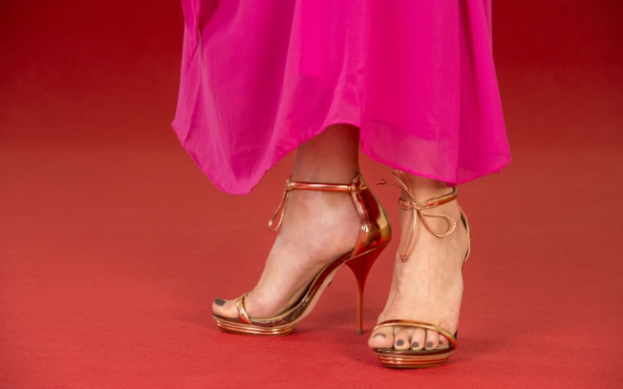 Sexy legs of a woman wearing golden high heels and a long pink dress on a red carpet. ; Shutterstock ID 283573304; Usage (Print, Web, Both): web; Issue Date: 12/31/18