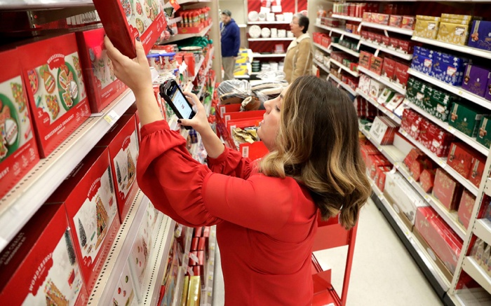 Target employee Lindsay Walker scans an item as she collects merchandise from shelves to prep them for an online order at a Target store in Edison, N.J. On Wednesday, Dec 5, the Institute for Supply Management, a trade group of purchasing managers, issues its index of non-manufacturing activity for NovemberService Sector, Edison, USA - 16 Nov 2018