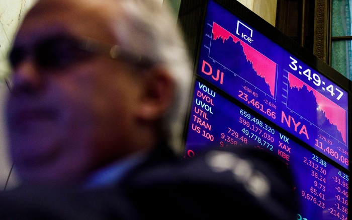 A board shows the value of the Dow Jones industrial average and other market indicators at the end of the trading day at the New York Stock Exchange in New York, New York, USA, on 17 December 2018. The Dow closed the day down over 500 points after falling over 600 earlier.New York Stock Exchange, USA - 17 Dec 2018