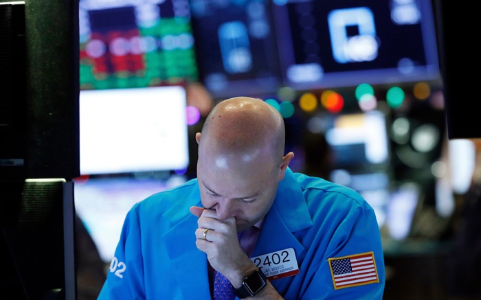Specialist Jay Woods works at his post on the floor of the New York Stock Exchange, . Wall Street's wild Christmas week goes, with the Dow Jones Industrial Average slumping 300 points at the open Thursday, a day after notching its biggest-ever point gainFinancial Markets Wall Street, New York, USA - 27 Dec 2018