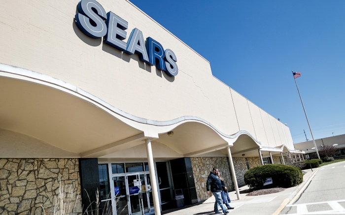 """Shoppers exit a Sears department store at the Tri-County Mall, in Springdale, Ohio. Sears, once the monolith of American retail, says that there is """"substantial doubt"""" that it will be able to keep its doors openSears-The End, Springdale, USA - 22 Mar 2017"""