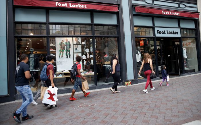 Shoppers walk past a Foot Locker store in Boston. On Tuesday, Aug. 29, 2017, the Conference Board releases its July index on U.S. consumer confidenceConsumer Confidence, Boston, USA - 25 Aug 2017