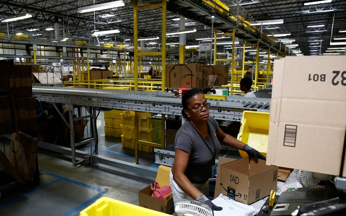 Myrtice Harris packages products for shipment at an Amazon fulfillment center in Baltimore. While jobs have been lost in brick-and-mortar stores, many more have been gained from e-commerce and warehousing. Amazon accounts for much of the additional employmentFuture Of Work-E-commerce Automation, Baltimore, USA - 03 Aug 2017