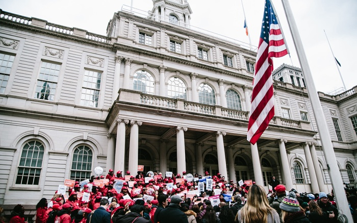 People gather on the steps of City Hall in a rally celebrating Equal Pay Day in New York, New York, USA, 10 April 2018. Women were encouraged to wear red colors for the rally to represent that women are still in the red.Equal Pay Day in New York, USA - 10 Apr 2018