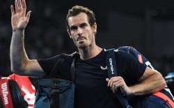 Andy Murray leaves the court after