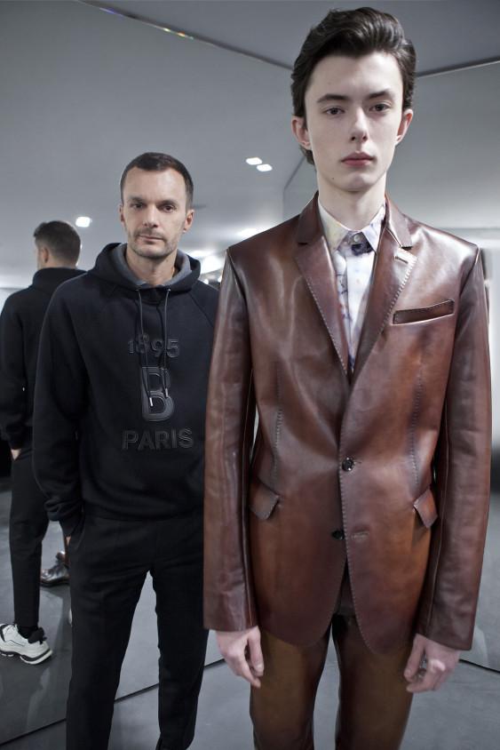 Kris Van Assche and one of his looks for Berluti Men's Fall 2019.