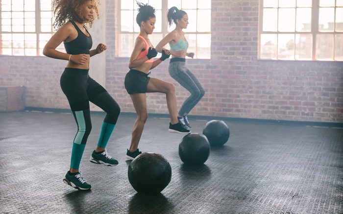 Young women exercising in aerobics class with medicine balls on floor. Three females doing workout together in gym.; Shutterstock ID 549174217; Usage (Print, Web, Both): Web; Issue Date: 1/22