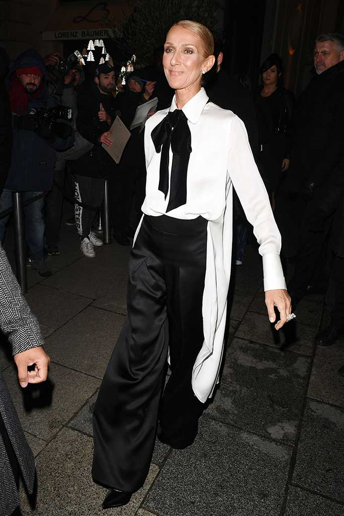 Celine Dion, thin, attends the Armani Prive show in an on trend tuxedo inspired ensemble.