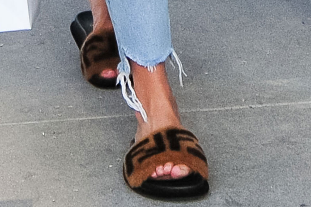 Chrissy Teigen, fendi, pool slides, celebrity shoe style
