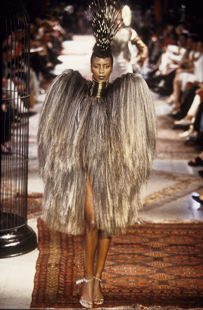 Dress made of hair with pointed shoulders worn with stacked gold neck rings and porcupine quill headpiece in the Givenchy Fall/Winter Couture 1997 show in Paris designed by Alexander McQueenGivenchy Fall 1997 HC, Paris