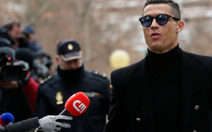 Cristiano Ronaldo arrives at the court in Madrid on . Cristiano Ronaldo is expected to plead guilty to tax fraud. The Juventus forward arrived in a black van, walked up some stairs leading to the court house and stopped to sign an autograph. The charges stem from his days at Real MadridCristiano Ronaldo, Madrid, Spain - 22 Jan 2019