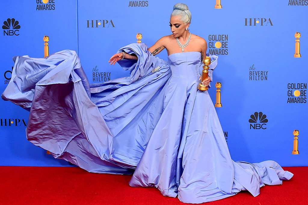 """Lady Gaga poses in the press room with the award for best original song, motion picture for """"Shallow"""" from the film """"A Star Is Born"""" at the 76th annual Golden Globe Awards at the Beverly Hilton Hotel, in Beverly Hills, Calif76th Annual Golden Globe Awards - Press Room, Beverly Hills, USA - 06 Jan 2019"""