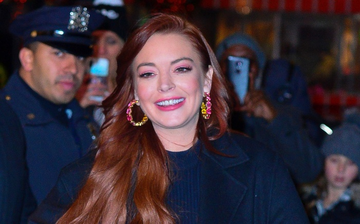 Lindsay Lohan bundled up to brace the frigid cold tonight as she stepped out leaving MTV studios in New York. The scarlet appeared to be in high spirits as she came out to hop to her awaiting vehicle. She blows kisses and shows her huge smile and wave after stopping for over 20 waiting fans before heading back to her hotel from a day of promoting.Pictured: Lindsay LohanRef: SPL5052758 040119 NON-EXCLUSIVEPicture by: Pap Culture / SplashNews.comSplash News and PicturesLos Angeles: 310-821-2666New York: 212-619-2666London: 0207 644 7656Milan: 02 4399 8577photodesk@splashnews.comWorld Rights