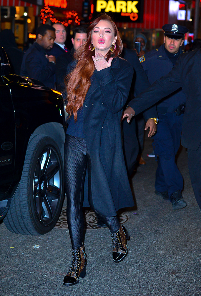 louis vuitton star trail combat boots, Lindsay Lohan bundled up to brace the frigid cold tonight as she stepped out leaving MTV studios in New York. The scarlet appeared to be in high spirits as she came out to hop to her awaiting vehicle. She blows kisses and shows her huge smile and wave after stopping for over 20 waiting fans before heading back to her hotel from a day of promoting.Pictured: Lindsay LohanRef: SPL5052758 040119 NON-EXCLUSIVEPicture by: Pap Culture / SplashNews.comSplash News and PicturesLos Angeles: 310-821-2666New York: 212-619-2666London: 0207 644 7656Milan: 02 4399 8577photodesk@splashnews.comWorld Rights