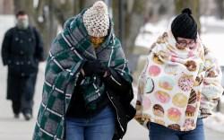 Pedestrians bundle up in sub-freezing temperatures