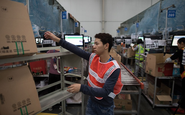 Workers in a TMall.com warehouse gather orders from customers in Jiangmen, Guangdong Province, China, 28 November 2018 (issued 29 November 2018). Jiangmen is situated in the Pearl River Delta economic zone which is one of China's leading economic regions and a major manufacturing centre.Workers in a TMall.com warehouse in Jiangmen, Heshan City, China - 28 Nov 2018
